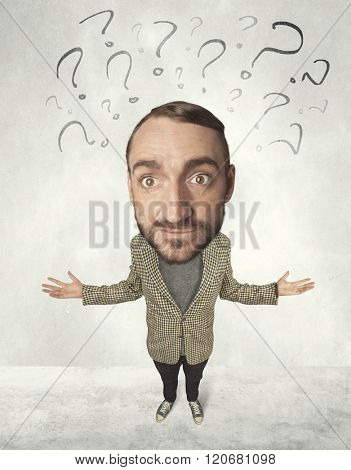 Funny person with big head and drawn question marks over it