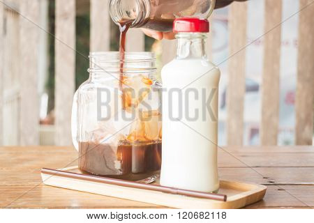 Pouring Espresso To Iced Glass Of Coffee