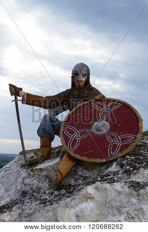 Knight Sitting On A Rock