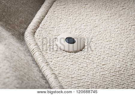 Corner of car mat with floor holder