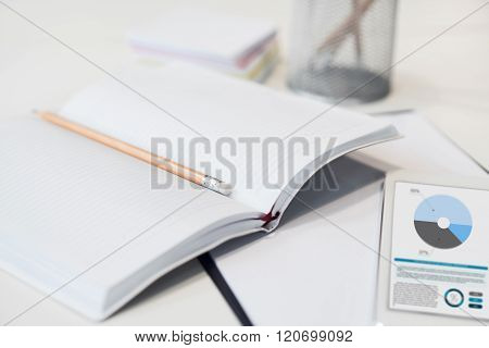 Notebook with pencil lying on the table