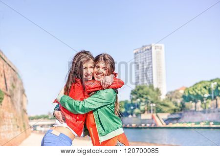 Best Hipster Friends Hugging Each Others With Skyscraper In Background