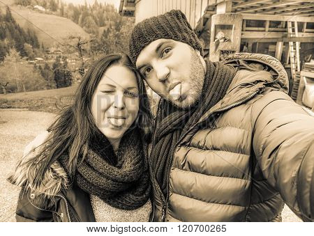 Handsome Young Couple Taking Selfie In The Mountains On Winter Season