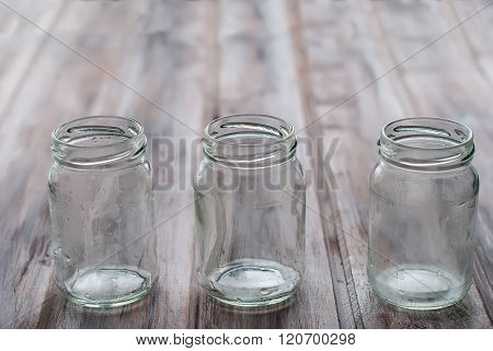 Empty Cans On A Wooden Table
