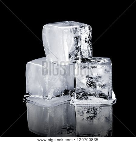 Three Ice Cubes Isolated On A Black Background