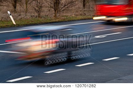 Speeding Cars At A Crossroad