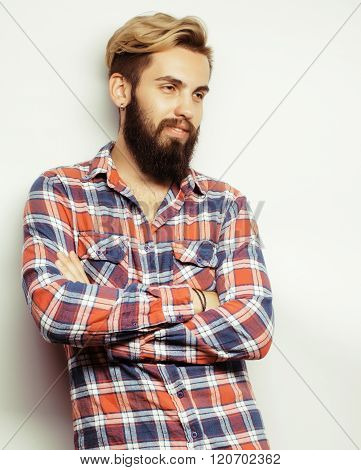 portrait of young bearded hipster guy smiling on white background close up, brutal man