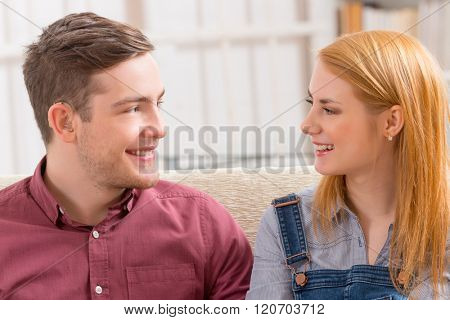Smiling young woman with her hearing impairment man