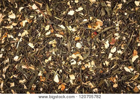 aromatic green dry tea with fruits and petals