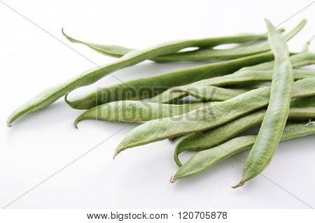 photos of fresh runner beans on white background