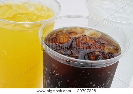 Image of fizzy drinks in plastic beakers