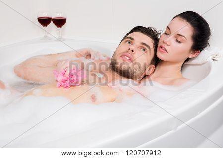 Adorable couple in bathroom