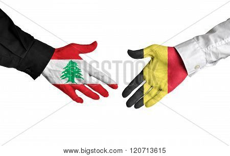 Lebanon and Belgium leaders shaking hands on a deal agreement