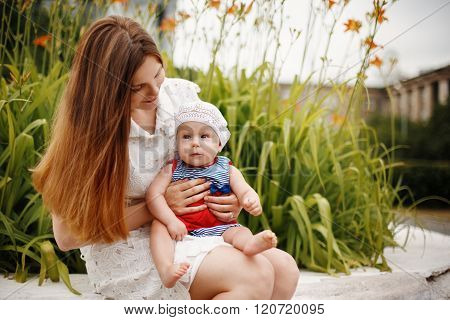 Toddler Sitting On Mother`s Knees