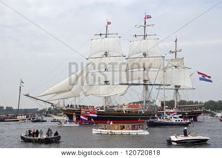 AMSTERDAM THE NETHERLANDS - AUGUST 19 2015: Clipper Sail ship 'Stad Amsterdam' in the North Sea Canal enroute to Amsterdam to particiate in the SAIL 2015 event.