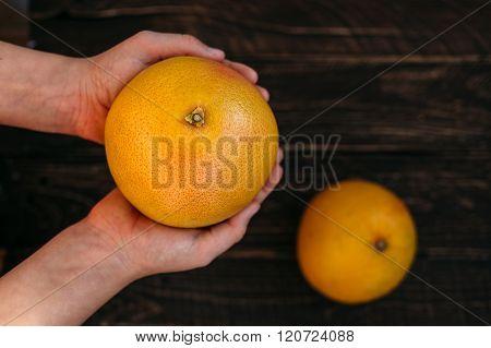 Grapefruit In The Hands Of