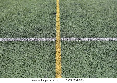 Detail Of Crossed Yellow And White Lines On Football Playground. Lines In A Soccer Field Made From G