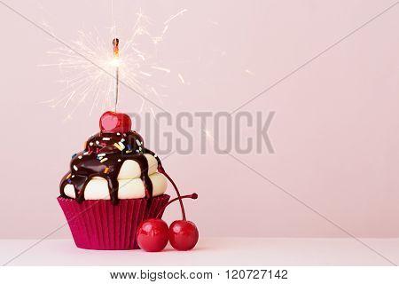Ice cream sundae cupcake with sparkler