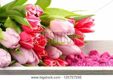 Tulips And Decoration Stones On Wooden Tray