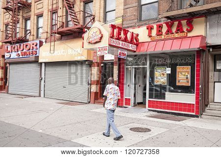 Man Walking On A Street Of Harlem.