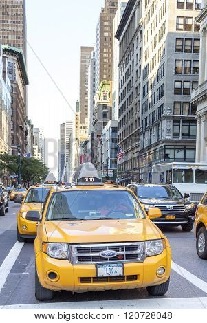 City Cabs Waiting In A Traffic On Street Of Manhattan.