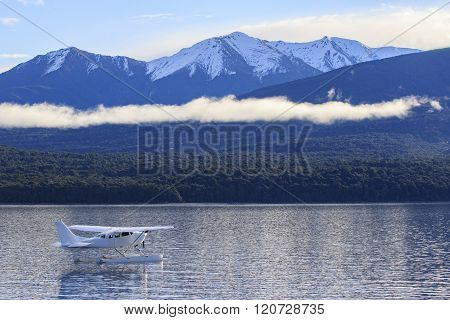 Water Plane Floating Over Fresh Water Lake Against Beautiful Mountain Scenery In Lake Te Anau New Ze