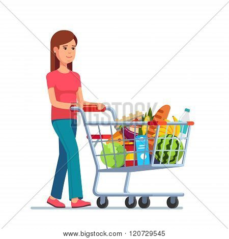 Young woman pushing supermarket shopping cart