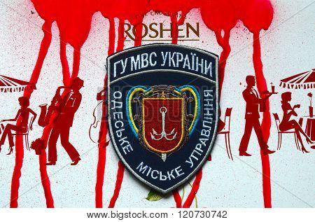 Kiev,Ukraine.FEB 20 ILLUSTRATIVE EDITORIAL.Chevron of Ukrainian Police. With logo Roshen Inc. Trademark Roshen is property of Ukrainian president Poroshenko.At February 20,2016 in Kiev, Ukraine
