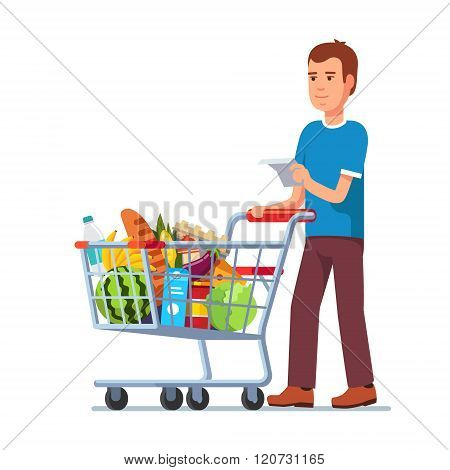 Young man pushing supermarket shopping cart
