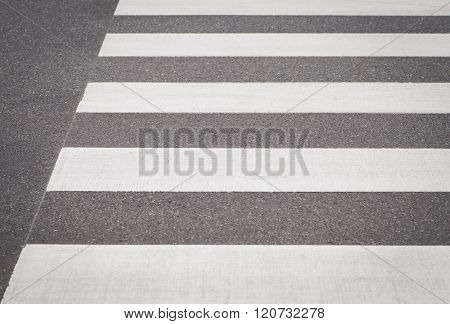 Close - up zebra crossing from empty street