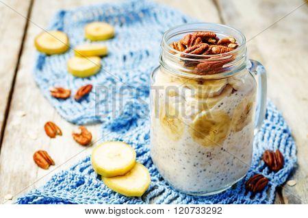 homemade healthy Chia seeds and banana overnight oatmeal in jar