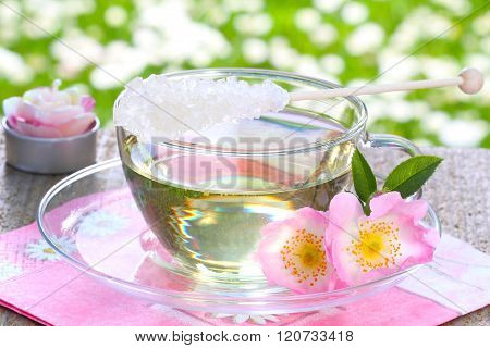 Rose blossom tea wild roses in a cup of glass