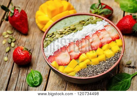 Spinach Smoothie Bowl With Strawberries, Coconut, Mango, Pumpkin Seeds And Seeds Chia