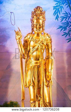 Golden Statue Of Kuan Yin .