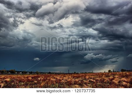 Thunderstorm over the field