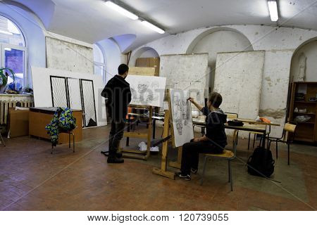 ST. PETERSBURG, RUSSIA - FEBRUARY 25, 2016: Students working in the workshop of of Art and Industry Academy named after Alexander von Stieglitz. The Academy enrolls 1500 students