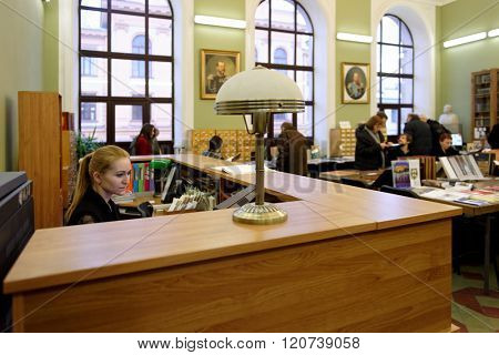 ST. PETERSBURG, RUSSIA - FEBRUARY 25, 2016: People in the library of Academy during the celebration of 140th anniversary of Art and Industry Academy named after Alexander von Stieglitz