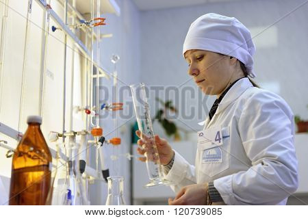 ST. PETERSBURG, RUSSIA - FEBRUARY 25, 2016: Olga Agarkova participates in the professional skills contest among chemical analysis technicians. The contest is held by the municipal water utility