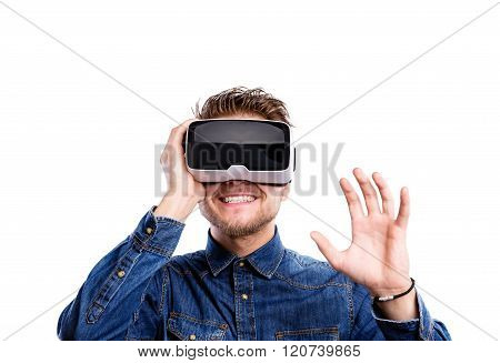 Man wearing virtual reality goggles. Studio shot, white backgrou