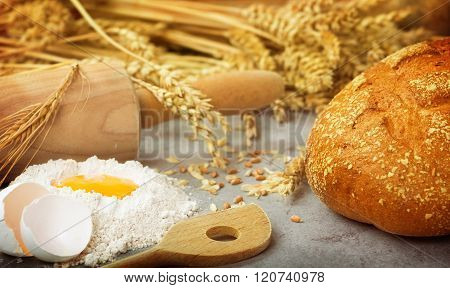 Bake fresh bread with flour, eggs and wheat ears