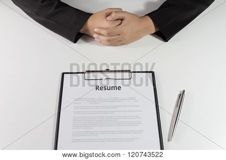 Business Woman Sitting With Resume In Front Of Her