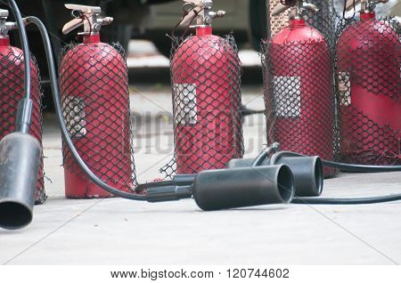 Fire extinguishers (Chemical Powder,Dry)-Being used-Fire protection equipment