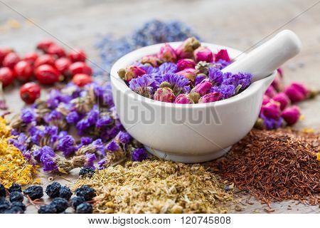 Mortar Of Healing Herbs, Herbal Tea Assortment And Dry Berries On Table. Herbal Medicine.