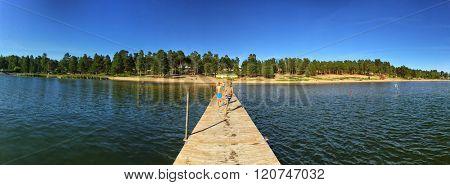 HUDIKSVAL, SWEDEN - AUGUST 2015: Children Running on a Pier at Lake Summer Camping