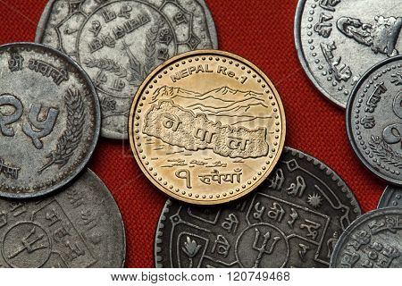 Coins of Nepal. Map of Nepal and the Himalayas depicted in the Nepalese one rupee coin.