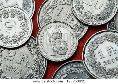 Coins of Switzerland. Standing Helvetia depicted in the Swiss half franc coin.