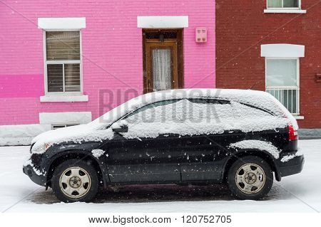 Montreal, Ca, 7Th March 2016. Black Car Covered With Snow In Front Of Pink Traditional House During