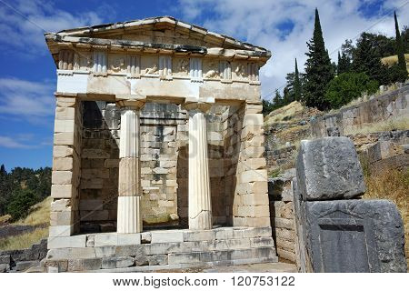 Building of Treasury of Athens in Ancient Greek archaeological site of Delphi, Greece
