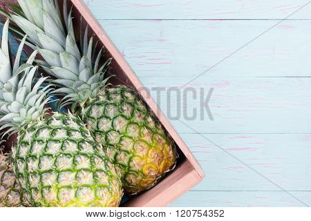 Fresh Pineapples In A Wooden Crate