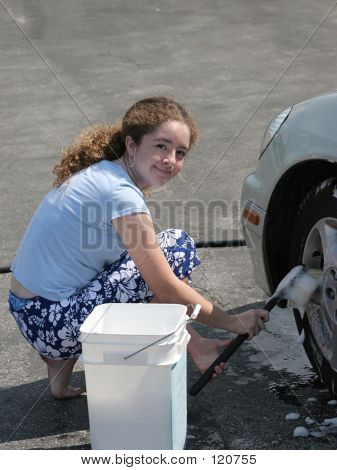 Teen Girl Washing Car